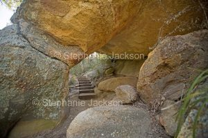 Steps on walking track leading through natural stone arch at Goulburn River National Park in NSW Australia