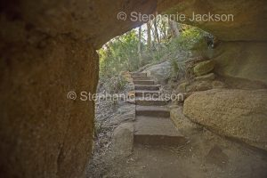 Steps on walking track leading through natrural stone arch at Goulburn River National Park in NSW Australia