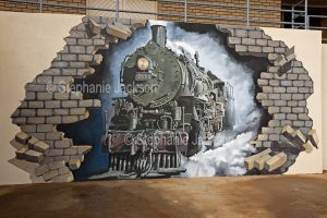Street art / mural of steam train painted on wall of building in Broken Hill in outback NSW Australia