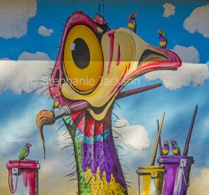 Street art / mural comical painting of emu on wall of bus shelter in Gulargumbone, NSW Australia