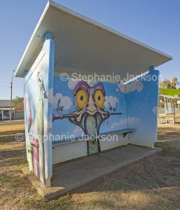 Street / public art. Bus shelter with humourous art work in town of Gulargumbone in NSW Australia.